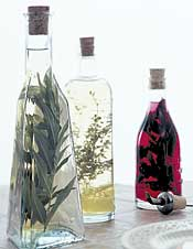 Herb infused vinegars add extra zest to your salad dressing! (herbalgardens.com)